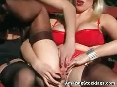 Two milfs in sexy stockings and garters making out