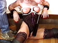 Brunette in black lingerie & boots, bound  and her tits teased