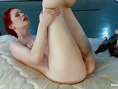Beautiful redhead swan pleasured with electricity by her brunette