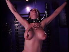 Hottie with a nice rack in bdsm action