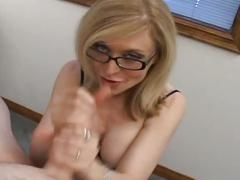 Sexy blonde mature takes big cock in mouth.