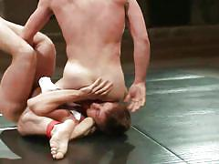 Two men wrestling naked and feeling each other's lust