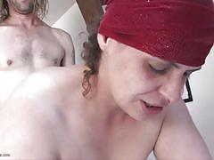 Chubby mature receiving a cock from behind