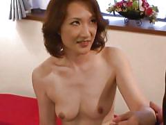 This asian milf wears only her stockings