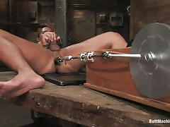 Gay masturbating while receiving anal pleasures from a butt machine