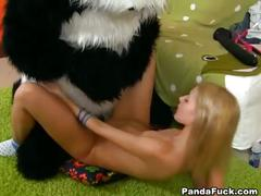 Nude teen girl has strapon sex with panda bear
