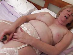 Blonde mature satisfying her with her favorite sex toy
