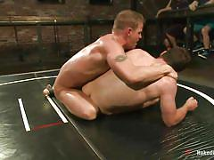 Muscled and sweaty gays wrestling