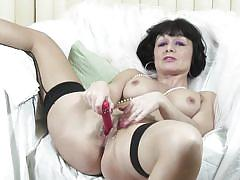 Mature lady barbie with a dildo