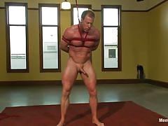Tied muscled gay guy filling his anus with a dildo