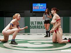 A tag team wrestling match between lesbians