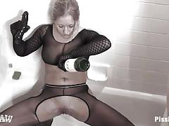 Lesbian wearing a gas mask pissing and getting pissed