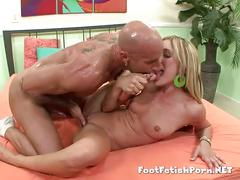 Blonde licking her toes