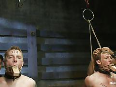 Two guys getting punished in bondage