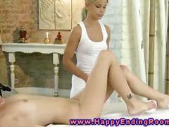 Blonde masseuse touching a wet pussy