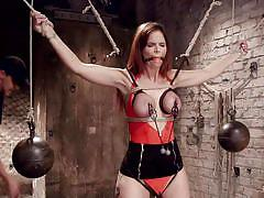 Redhead milf is tied up in the sex dungeon