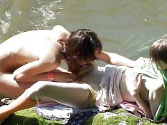 Skinny babes with natural tits making out outdoors.