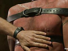 Bald hunk tied with leather belts and fucked in the mouth