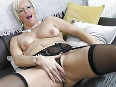 Short-haired blonde lady showing her pantyhose
