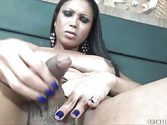 Beautiful brunette shemale undresses and masturbates solo