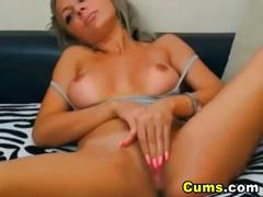 Busty slut fingers wet pussy on webcam