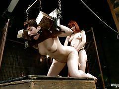 Redhead mistress fucking a cutie in the ass