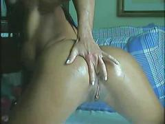 Brazilian whore takes dildo in ass.