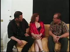 Mature redhead gives two men a blowjob then gets fucked