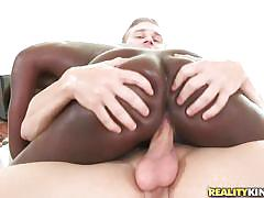 Round oiled ass on a white cock