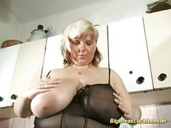 My mom shows her extreme oiled boobs