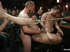 Tied white guy getting fucked hard while sucking cock