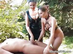 Bondage threesome outdoor action where