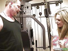 Blonde gives blowjob in the gym
