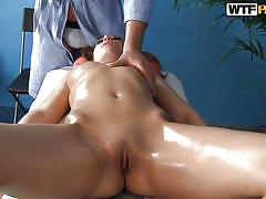 Oiled slut gets massaged inside too