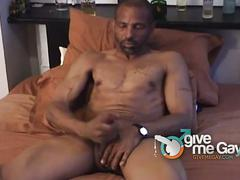 Hunky black thug in solo cock jerking session.