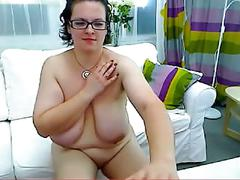 Chubby brunette plays with her pussy and tits