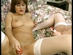Two vintage girls play together with their dildos