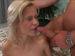 Blonde gets fucked in pussy and ass on the bed