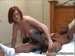 Redhead milf in lingerie and stockings nailed by black guy