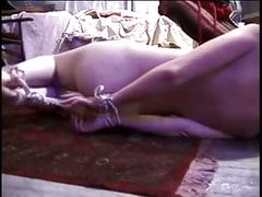 Redhead with nice naturals bound & gagged, lying on the ground