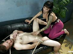 Brunette shemale torturing a guy's balls
