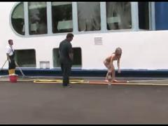 Blonde girl walking nude in the middle of the street