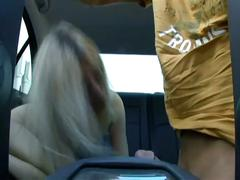 Blonde slut rides cock in a car