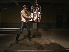 Slave is locked in a small cage