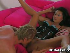 Busty asian lucy lee pounding her trimmed pussy