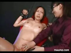 Roped shaved asian made to orgasm