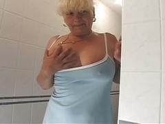 Busty blonde milf parties in the toilet