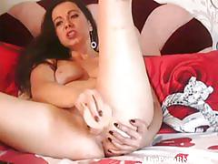 Watch this hot brunette fucking her holes(4)