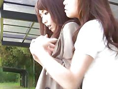 Asian girls all alone in a park