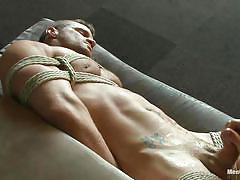 Muscled gay tied and sucked